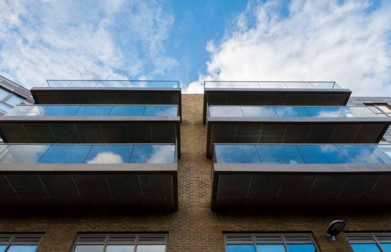 Structural glass balconies add minimalist style to Clapham development