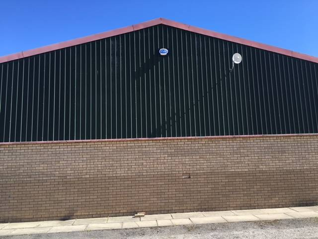 A Cladding Refurbishment Project with Specific Colouring Requirements