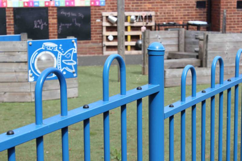 Downe primary school chooses anti-trap bow top fencing for safe playground environment