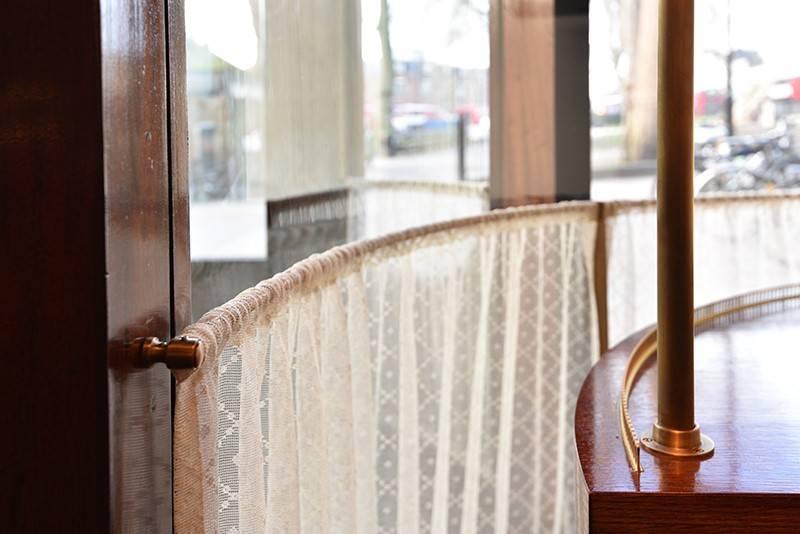 Classic Antique Brass cutain poles to London Restaurant