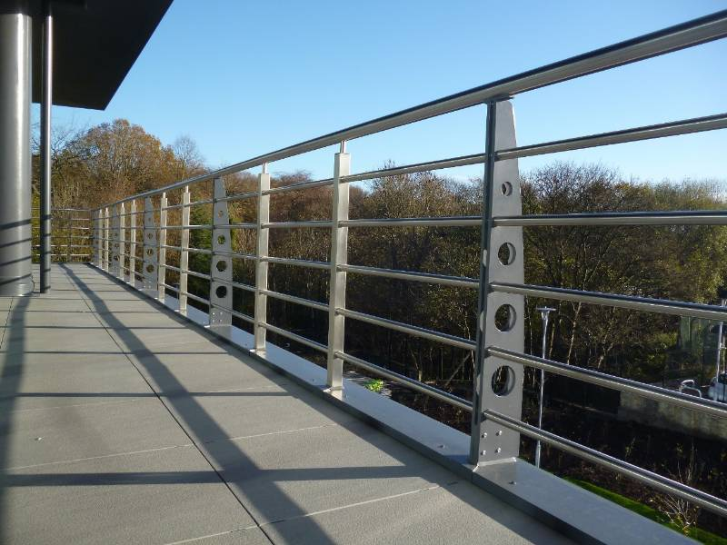 Bespoke balconies and balustrade bridge the aesthetic divide between traditional and contemporary