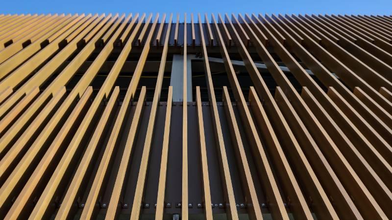 Wood finish solar shading on aluminium