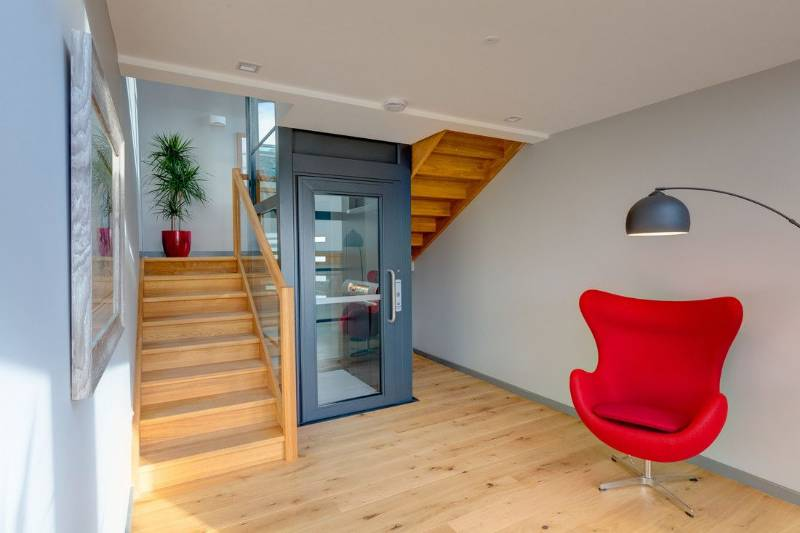 A Stannah platform lift lights up a new designer home in Devon