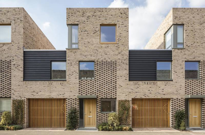 Ventilated garage doors enable seamless integration of vertical timber cladding