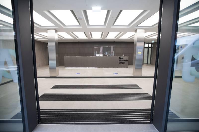 Cut-Into-Floor Entrance Mat Design at Five Norwich Street