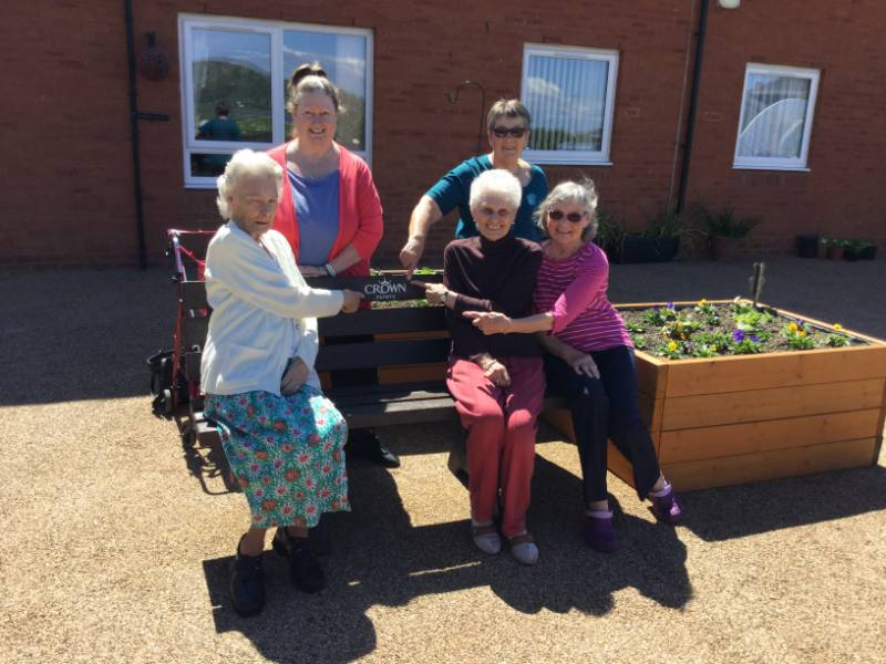 Crown Paints donates bench to sheltered housing scheme