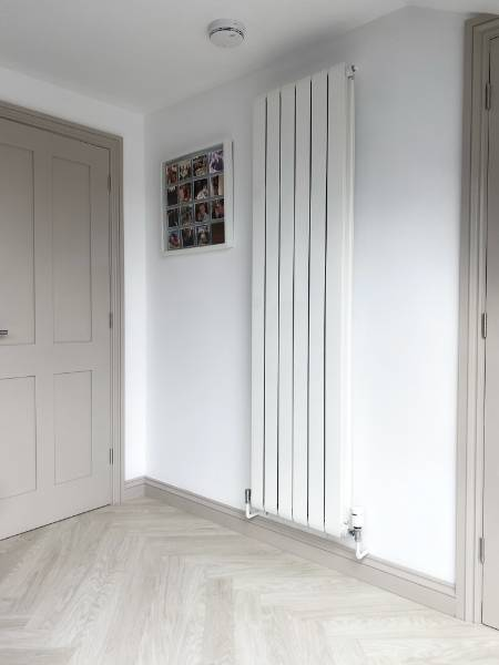 Afinia vertical radiators meet the brief for spacious loft conversion