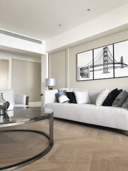 Modern luxury apartment features light chevron flooring