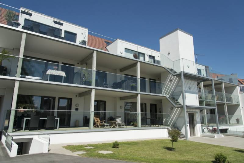 Private apartment building in Denmark features Easy Glass Slim glass balcony railings