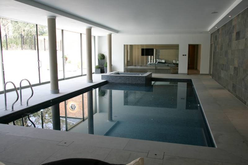 Stone bathrooms, kitchens, staircases, tiles and swimming pool for residential development