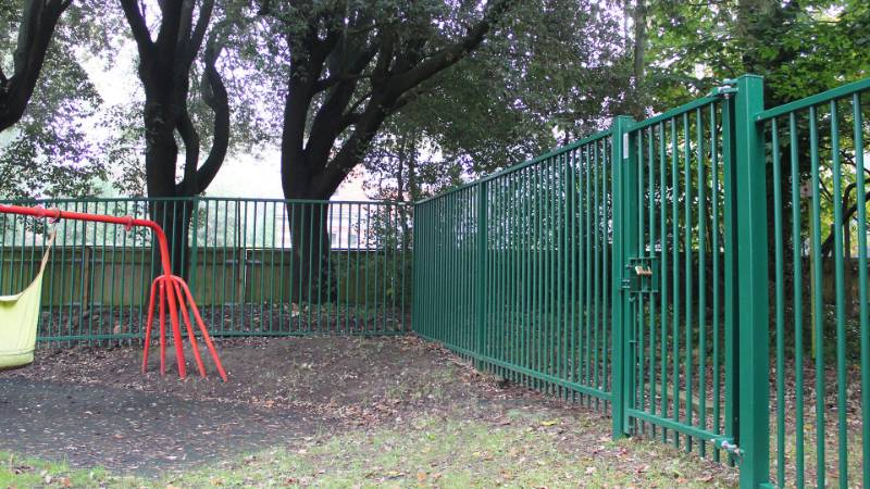 Vertical bar fencing protects Barnardo's special needs school