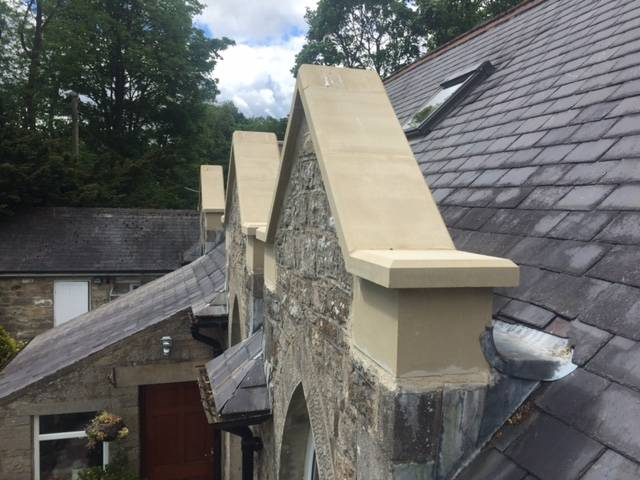 Replacement of old stone architectural features with cast stone replicas