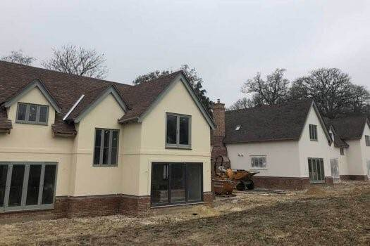 An exclusive residential development in Hambledon, Surrey, is making use of 12mm Magply boards, supplied by Elliotts Builders Merchants, as the carrier for a proprietar sprayed render system, as one