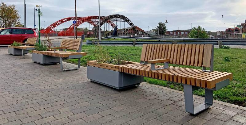 Planters and integrated seats enhance station forecourt