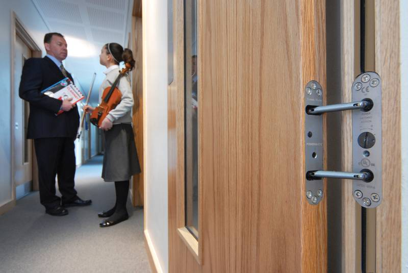 Concealed door closers hit right note at music school
