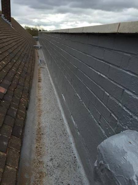 Concrete Gutter Repair with Liquasil's liquid gutter lining system