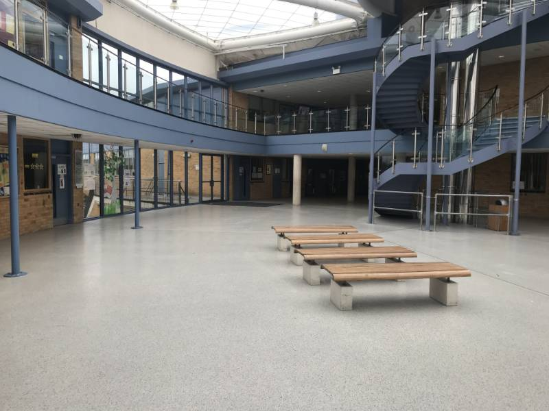 Decorative and seamless flooring supplied for atrium area to Radclyffe School