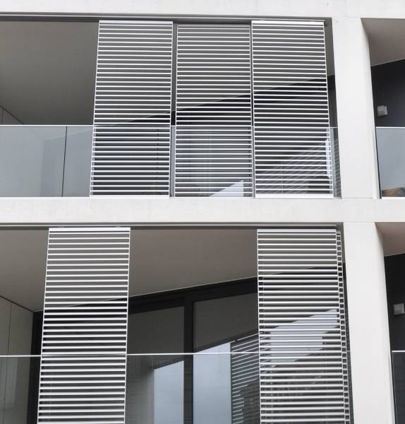 Apartment block Sint-Niklaas - Solar Shading Sliding Panels