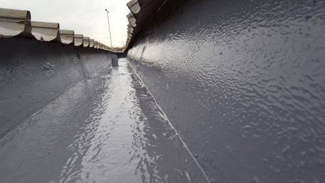 Liquid gutter lining system by Liquasil