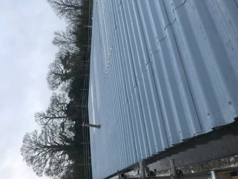 Asbestos roof cleaning & coating using Liquasil's BBA Approved roof coating, Asbestoseal
