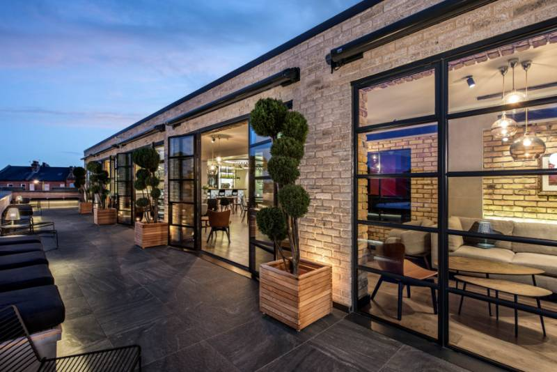 Clement steel screens create a sensational backdrop to roof terrace at iconic film studios