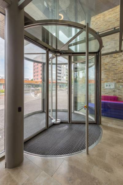RC2 Revolving Door With Unique Sliding Drum Wall Construction To Provide The Security Protection