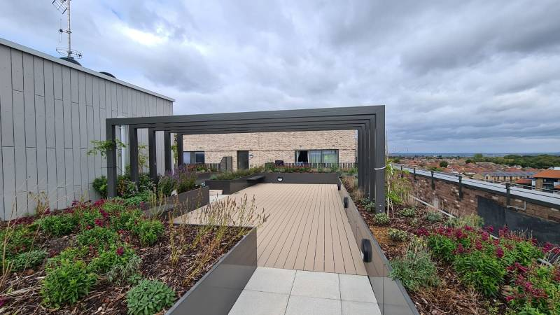 AKRI planters transform residential roof-top