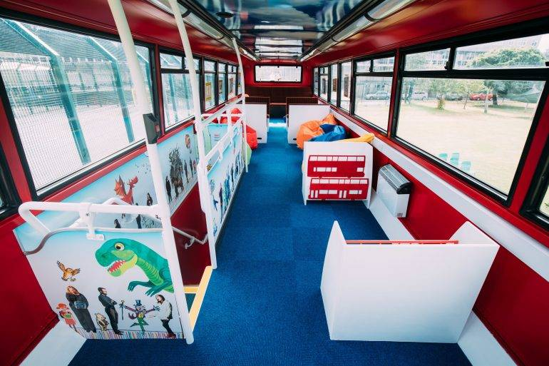Tolworth Nursery - F. Ball help to transform double-decker bus into library for schoolchildren