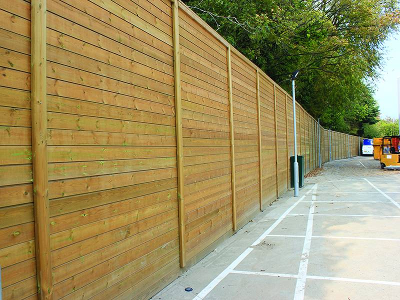 Acoustic fencing protects residents from noise at new retail complex