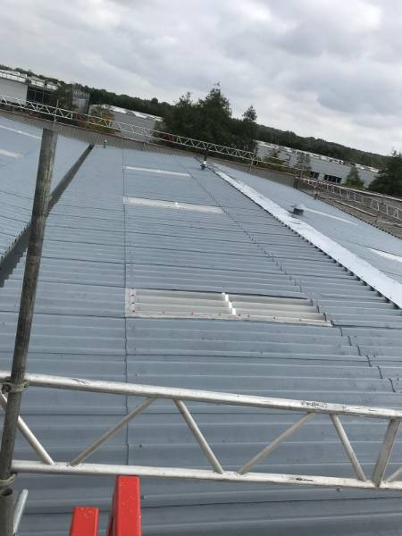 Asbestos roof coating project by Nadco Roofing Services, using the BBA Approved Asbestoseal system