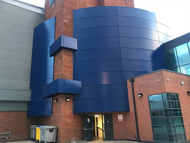 Re painting of external pre-finished powder coated wall panels.