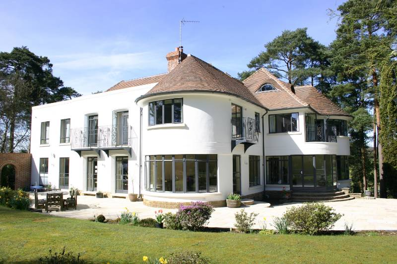 The addition of Clement steel windows, transforms this 1920s property in the Surrey Hills into a superb modern family house