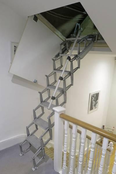 Loft ladder for sloped ceiling loft hatch