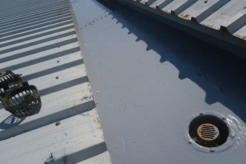 Liquid gutter lining project using Liquasil Gutterseal system on metal gutter