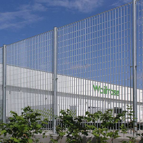 Waitrose Distribution: Roma-3 mild steel grating fence in a galvanized finish was specified for the boundary demarcation.