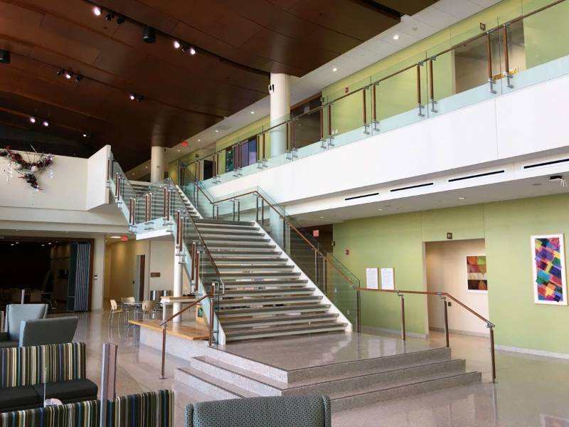 Healthcare Building featuring HDI's Kubit Railing and balustrade system with Oak Cladding