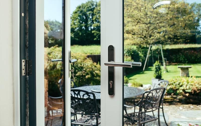 BLU™ - KM078B Mitre Lever Door Handle on Backplate