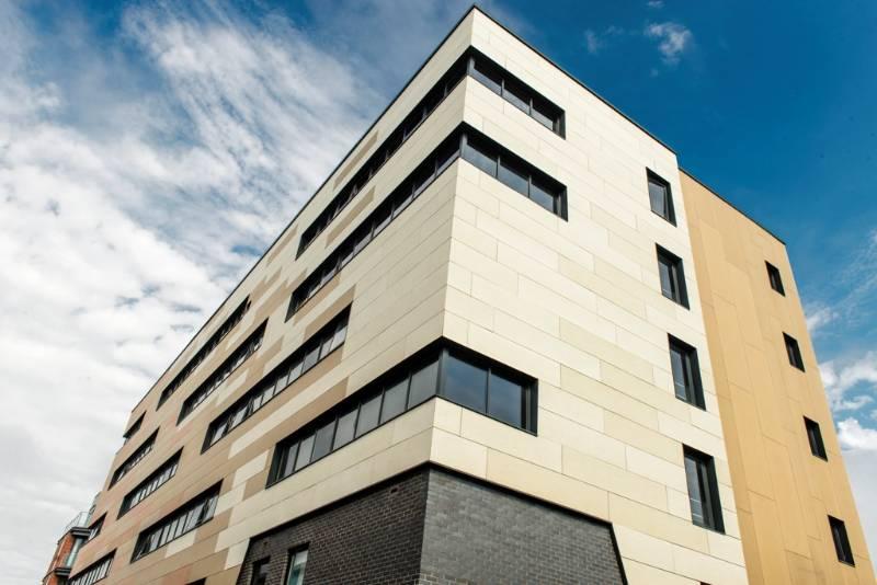 CEMBRIT FIBRE CEMENT CLADDING WRAPS STUDENT ACCOMODATION IN WARM COLOURS