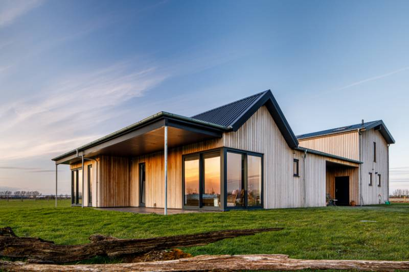 Factory coated Larch cladding