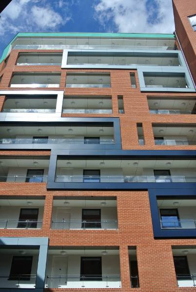 External wall insulation and rendered rainscreen cladding combine on this new build regeneration project