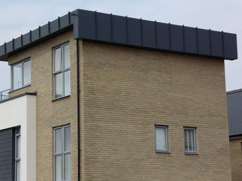 Cost Effective Aluminium Replaces Standing Seam Detail on New Housing Development