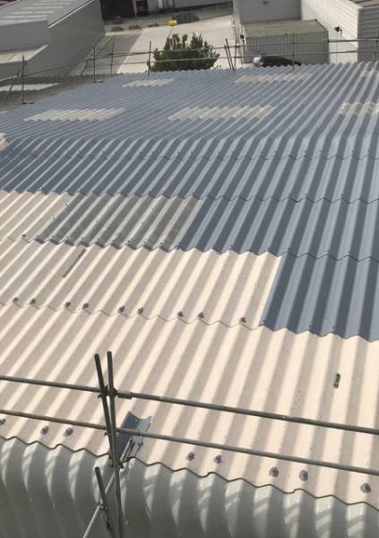 Asbestos cement roof refurbishment project & gutter lining using BBA Approved Asbestoseal
