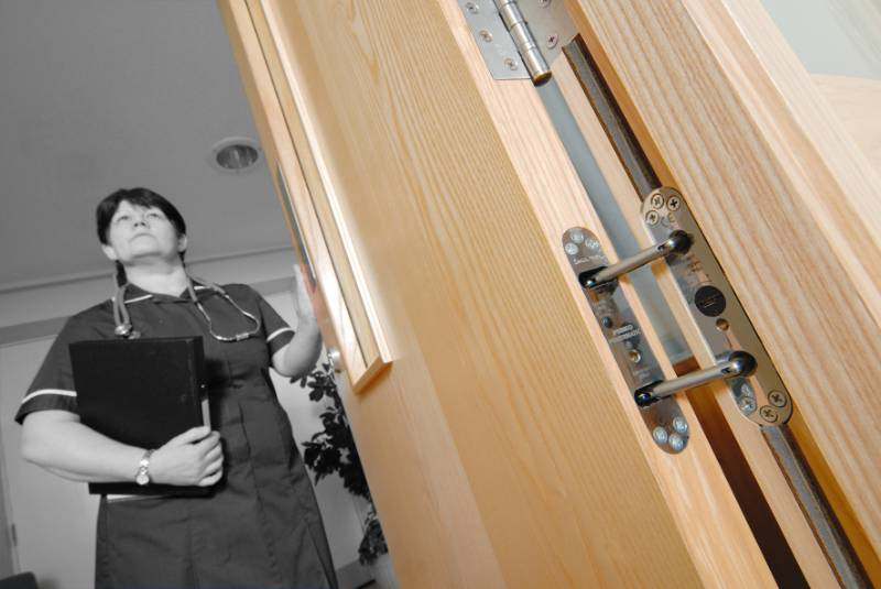 Concealed door closers assure safety at mental health unit