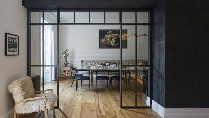 Fabulous interior complemented with tall, dark and handsome steel frames