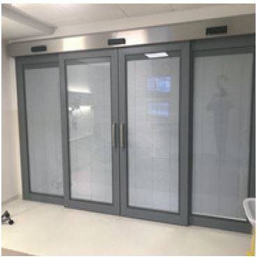 DT-A1 Hygieniglass sliding bi-parting door with fixed glazed panels